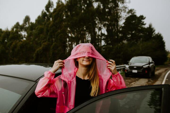A girl wearing a pink raincoat
